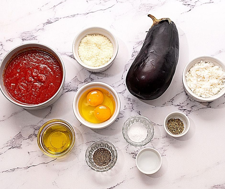 Ingredients for Eggplant Parmesan on white counter
