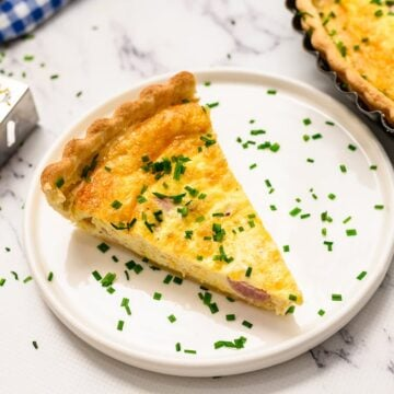 Quiche on white plate