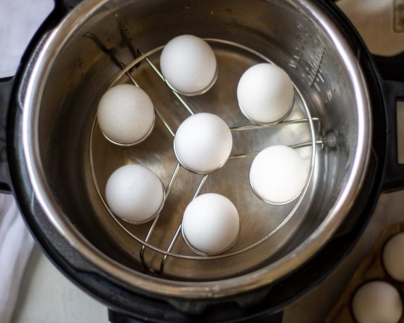 Eggs in egg rack inside pressure cooker