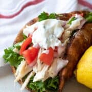 Pita bread stuffed with shredded chicken and diced tomatoes and Tzatziki