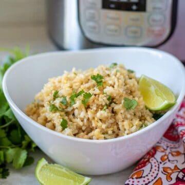 Bowl of Cilantro Lime Rice next to instant pot