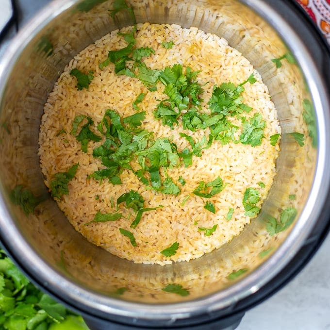 Instant Pot with Brown Rice and Cilantro in inner pot