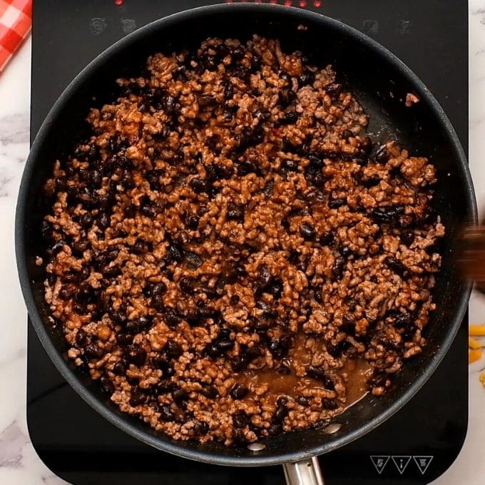 Taco Meat in skillet with beans.