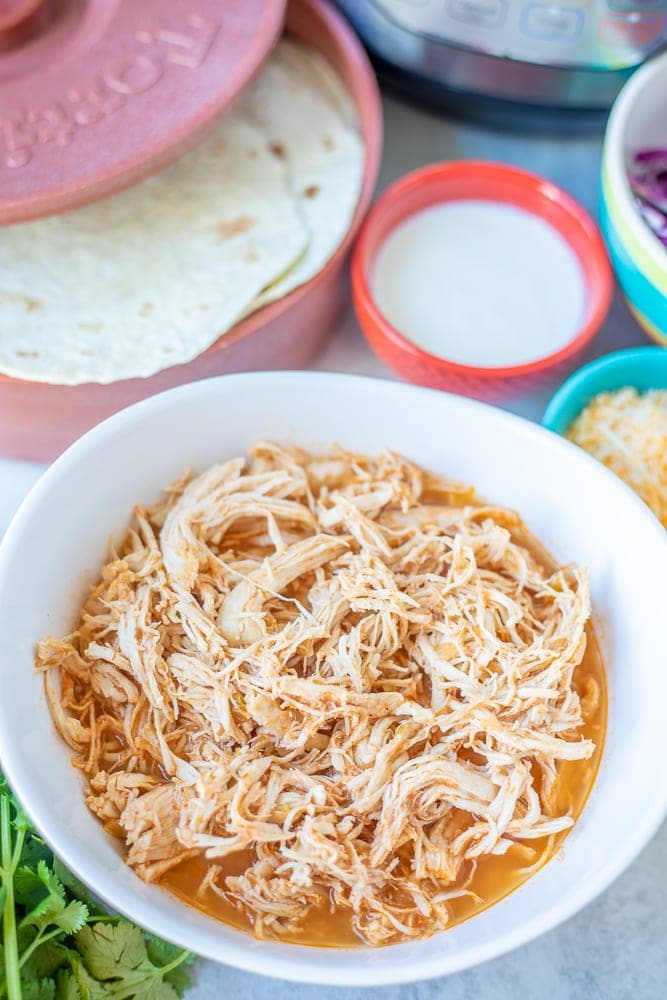 Shredded Chicken Taco Meat in White Bowl