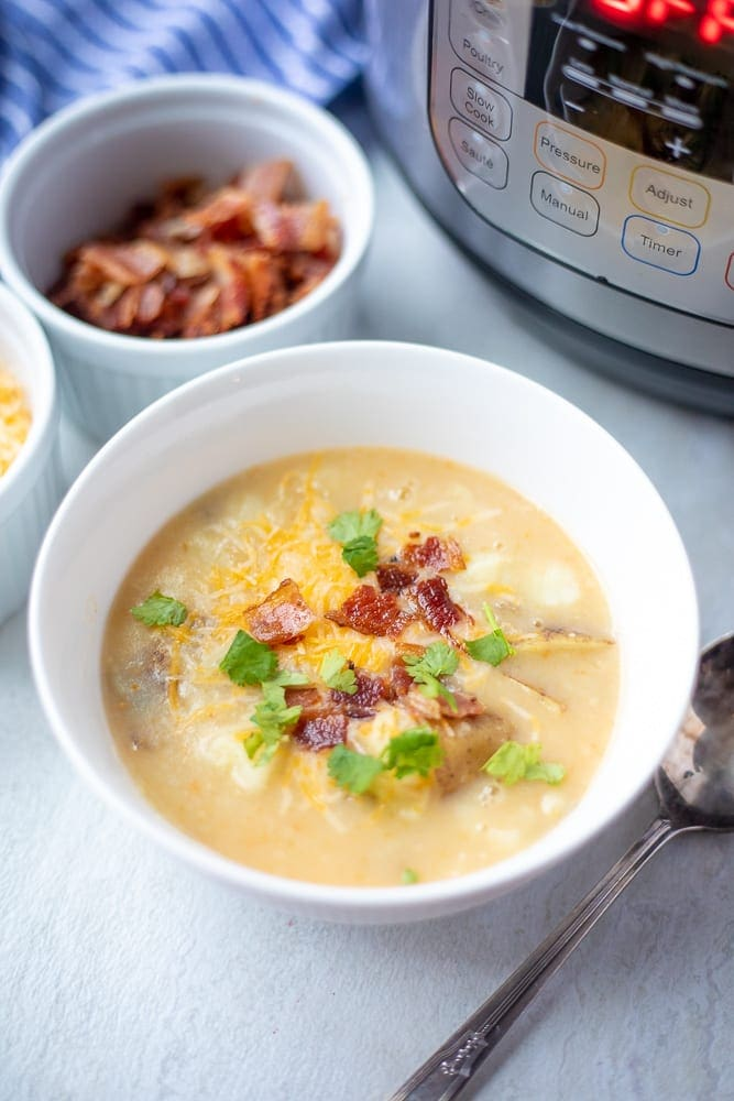 White bowl filled with creamy Instant Pot Soup