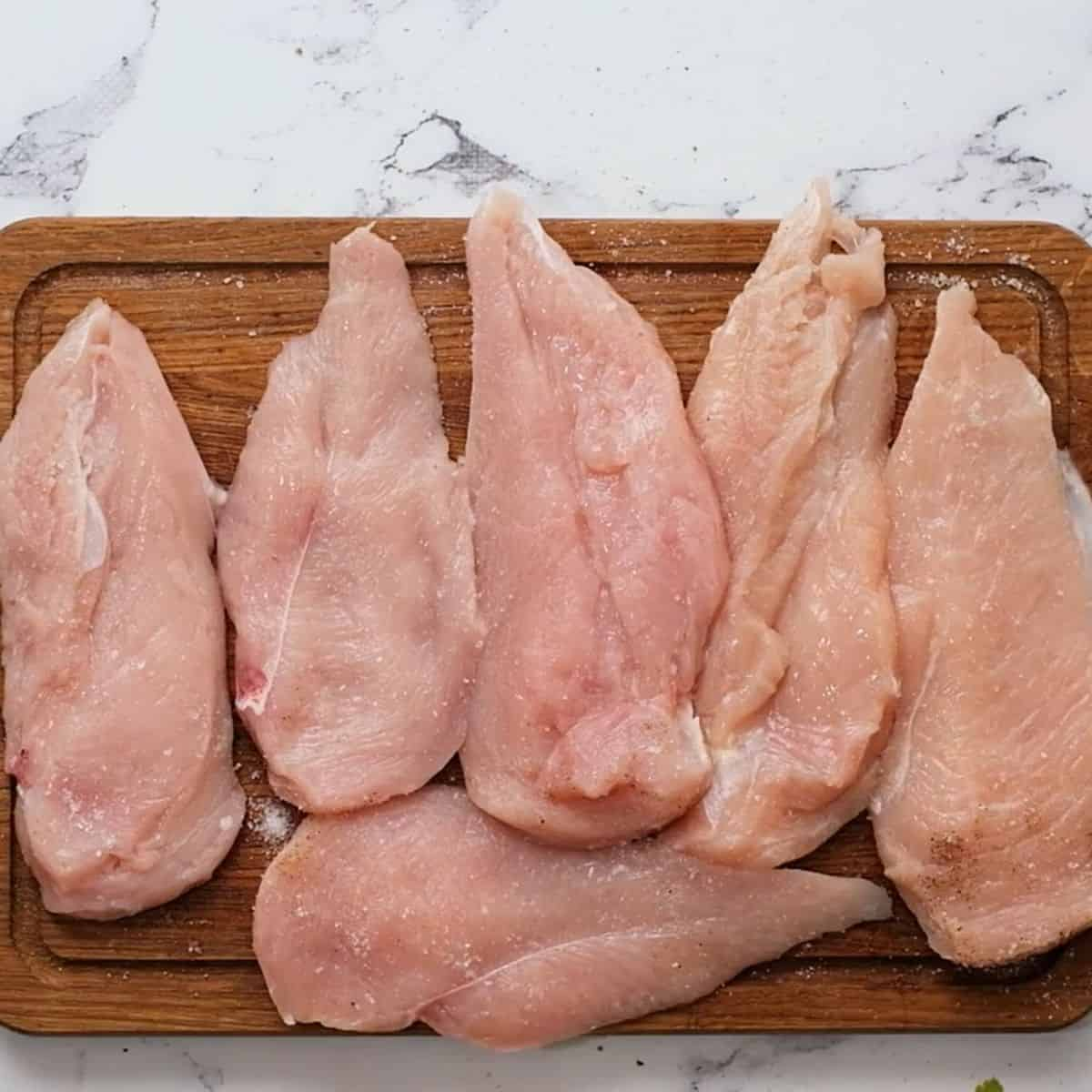Chicken Breasts seasoned with salt and pepper.