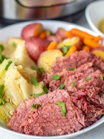 Corned Beef and Cabbage on White Platter with Potatoes and Carrots