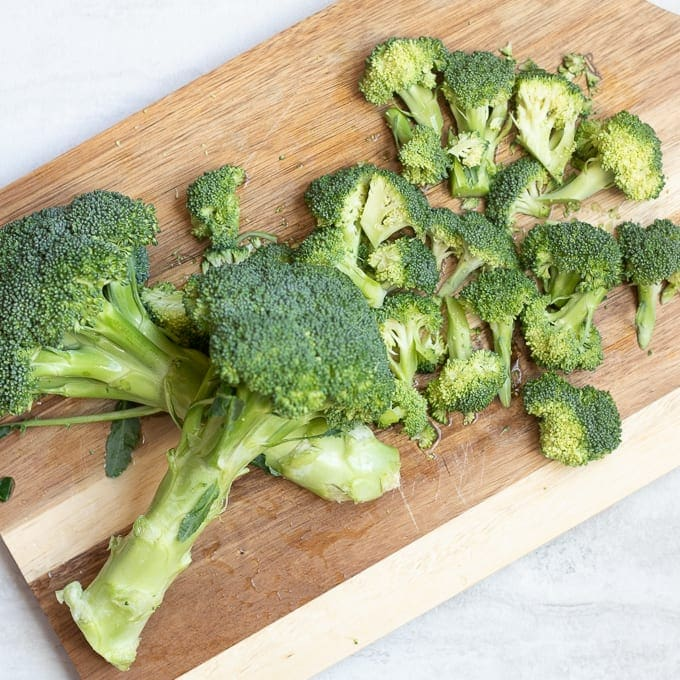 Cutting Board with chopped fresh broccoli