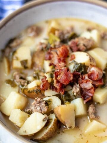 Bowl of Zuppa Toscana topped with bacon