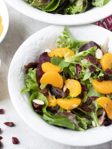 Spinach sald topped with mandarin oranges