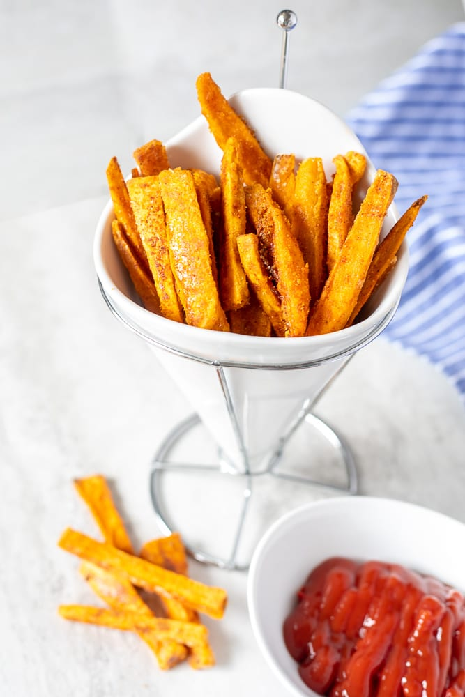 Basket of Baked Sweet Potato Fries next to ketchup