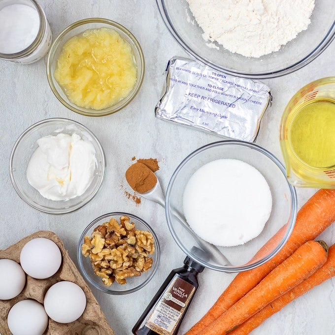 Ingredients for Carrot Cake Cheesecake on white counter