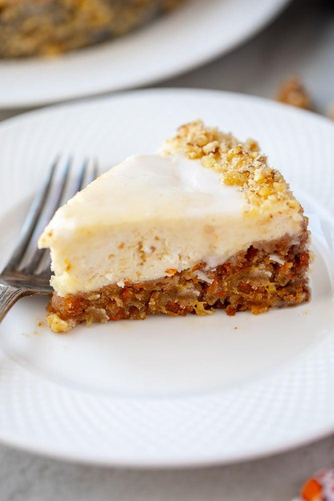 Carrot Cake Cheesecake slice on white plate