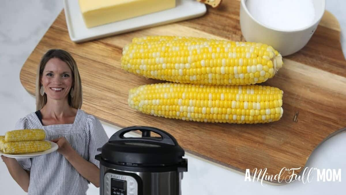 Corn on the cob on a wooden cutting board with Kristen next to instant pot holding corn.