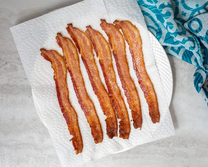 Baked Bacon on paper towel lined plate