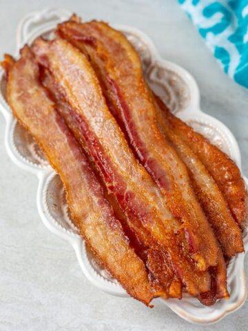 Crispy Oven Baked Bacon on White Plate