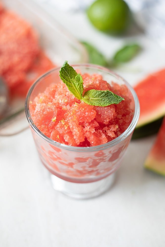 Watermelon Granita in glass bowl with mint leaves and mint sugar