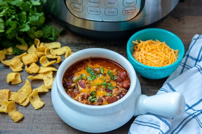Bowl of Instant Pot Chili Next to Instant Pot