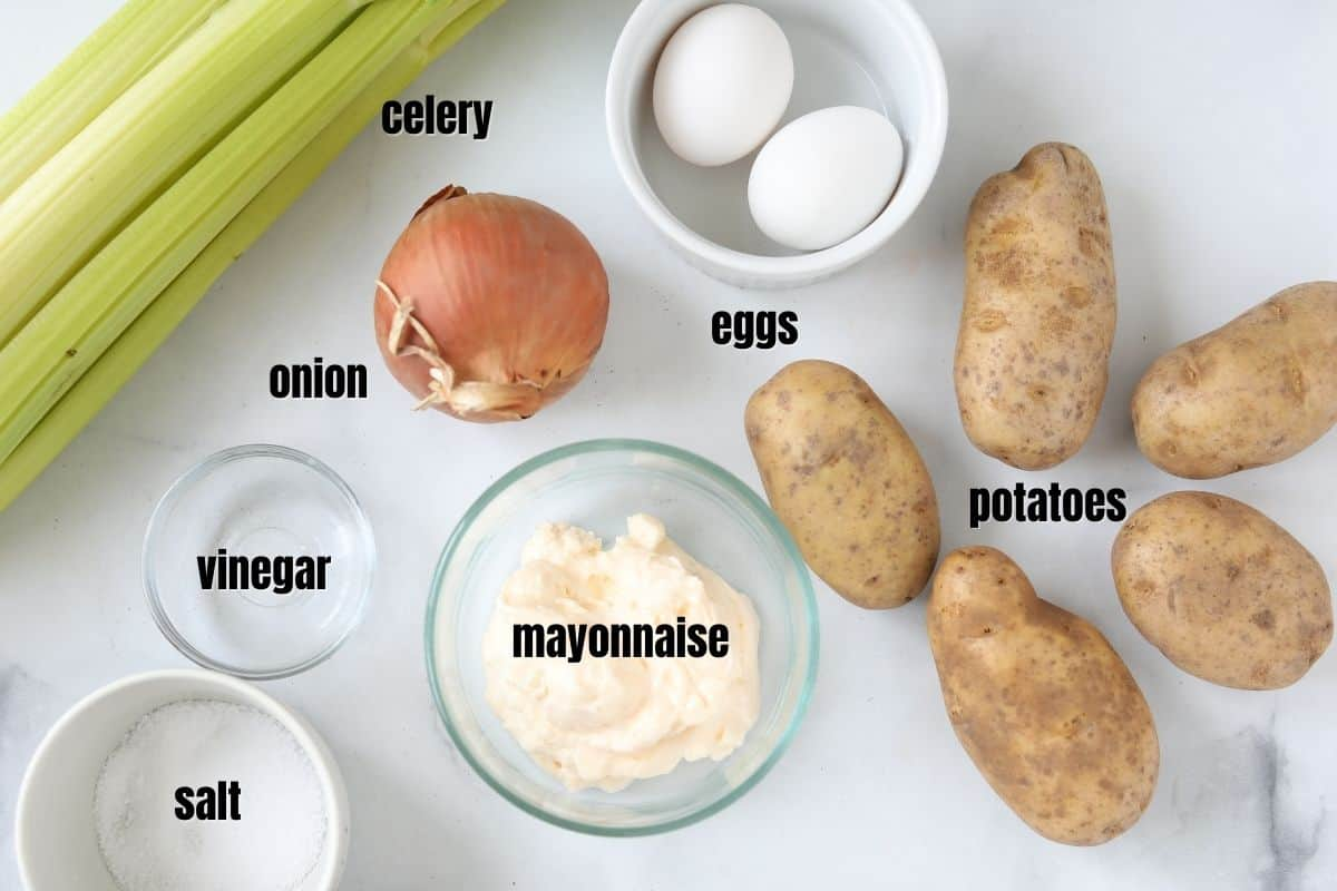 Ingredients for potato salad labled on counter.