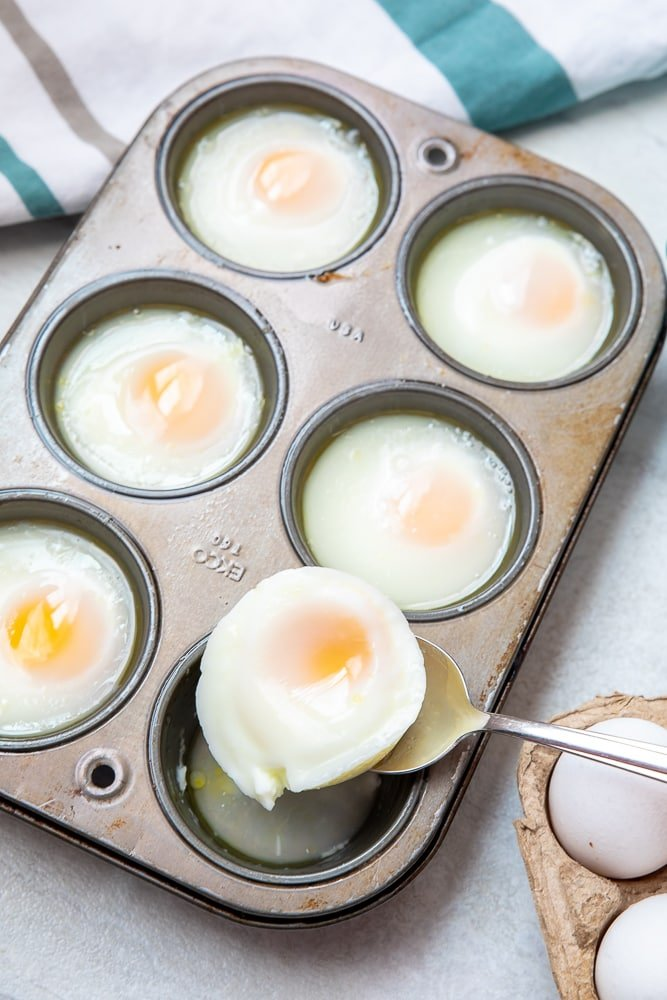 Spooning out poached egg from Muffin Tin