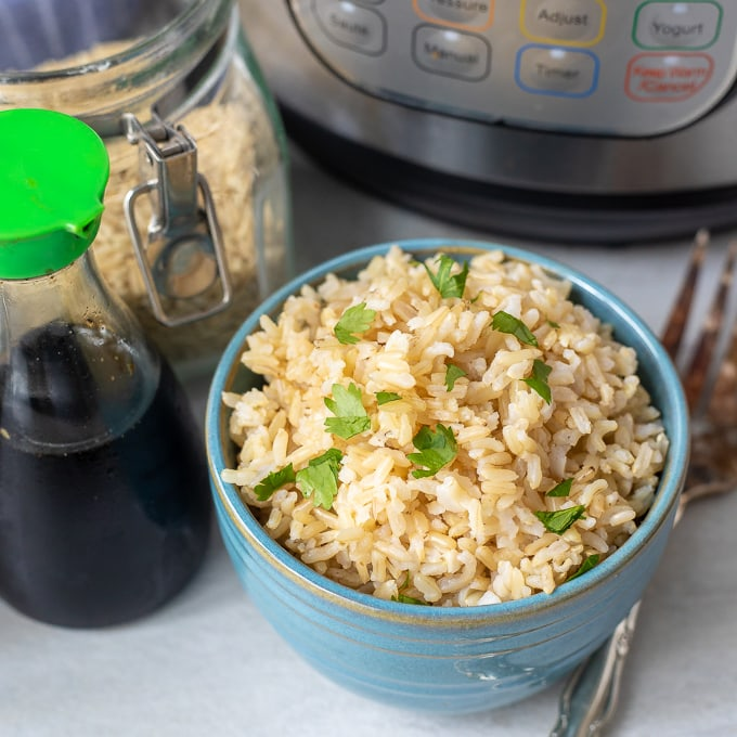 Brown Rice in Blue Bowl next to instant pot