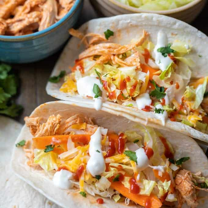 Close up of two buffalo chicken tacos