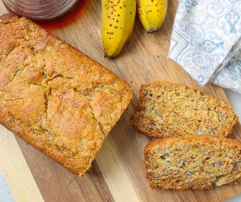 Healthy Banana Bread sliced on wooden cutting board