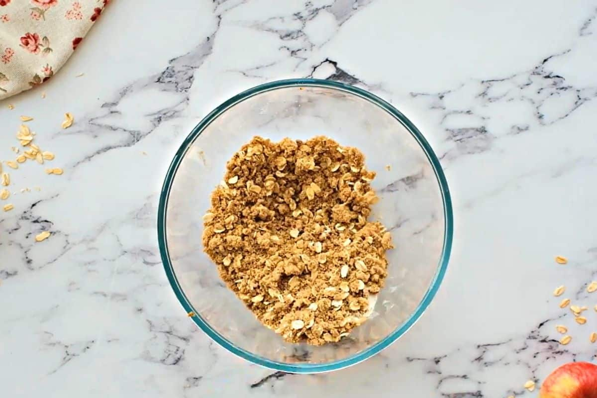 Oat crisp topping in mixing bowl.