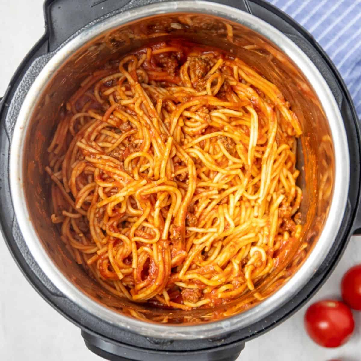 Spaghetti tossed together with meat sauce in instant pot.