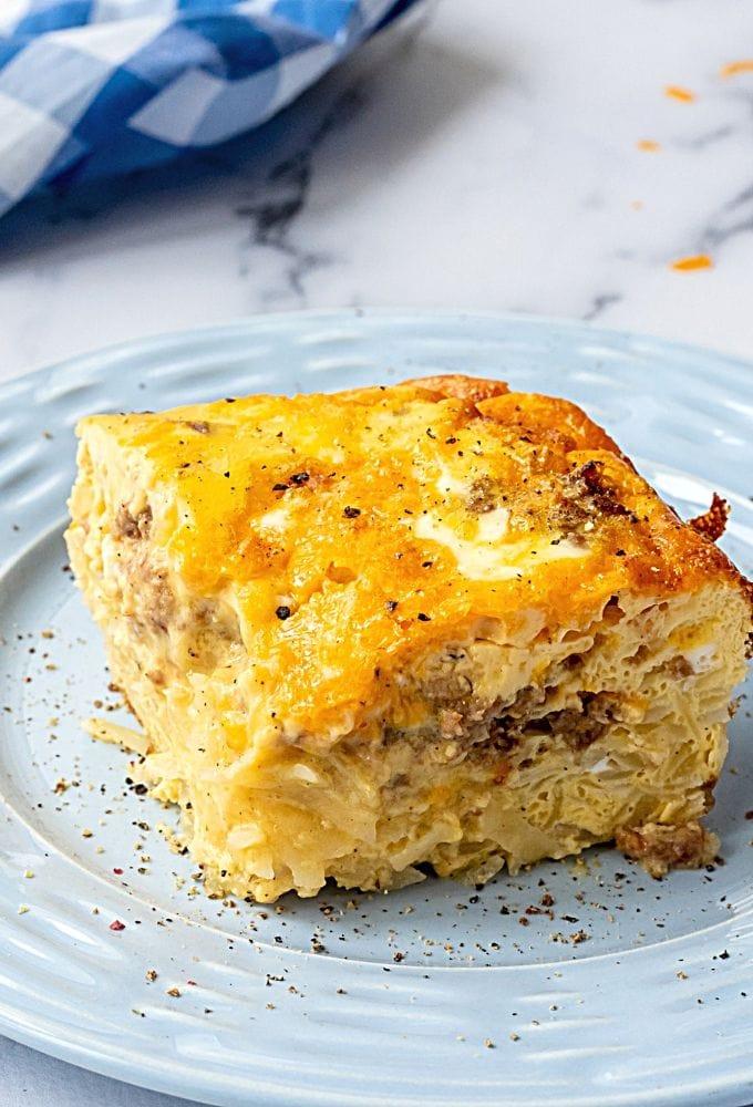 Slice of Hashbrown Breakfast Casserole on blue plate