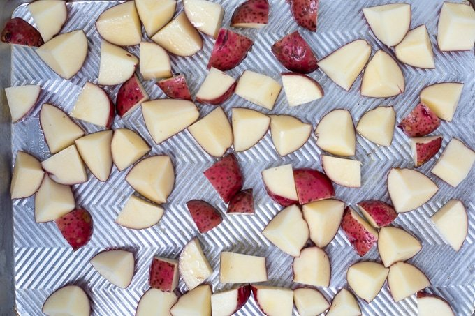 Sheet pan with potatoes spread out evenly