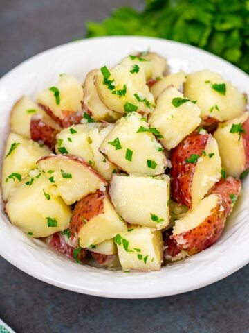 Bowl of red buttered potatoes with parsley