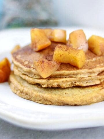 Stack of sweet potato pancakes with apple compote.