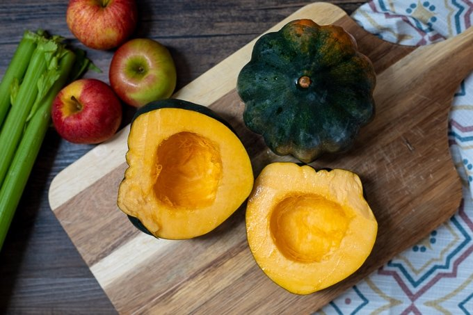 Acorn Squash cut open on wooden cutting board