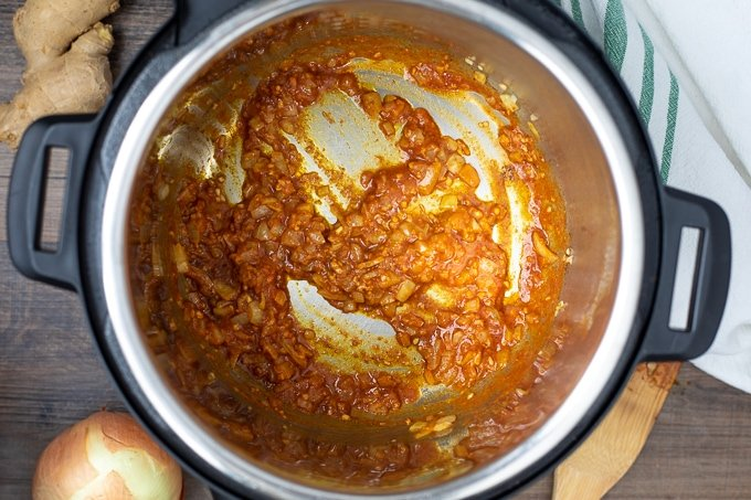 Spices and tomato paste toasted in Instant Pot