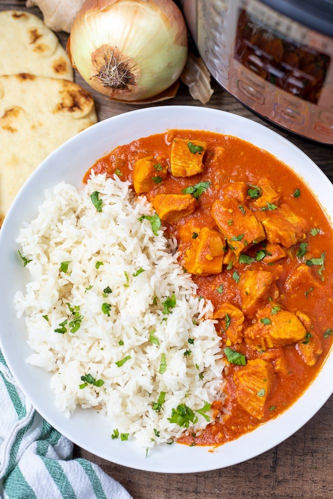 Bowl of Instant Pot Butter Chicken served with white rice