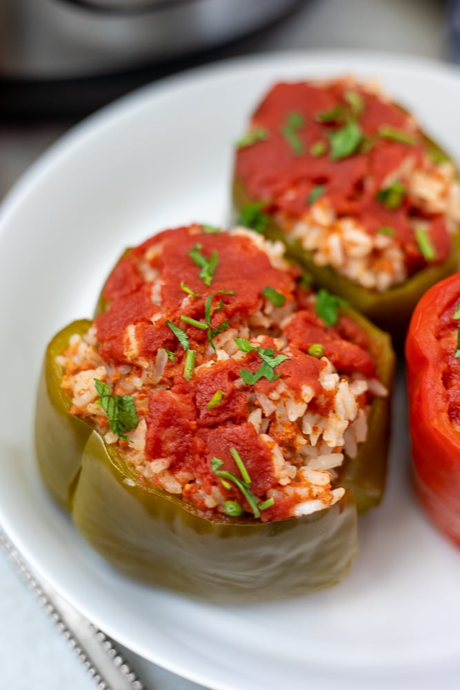 Close up of an Instant Pot stuffed pepper on a white plate