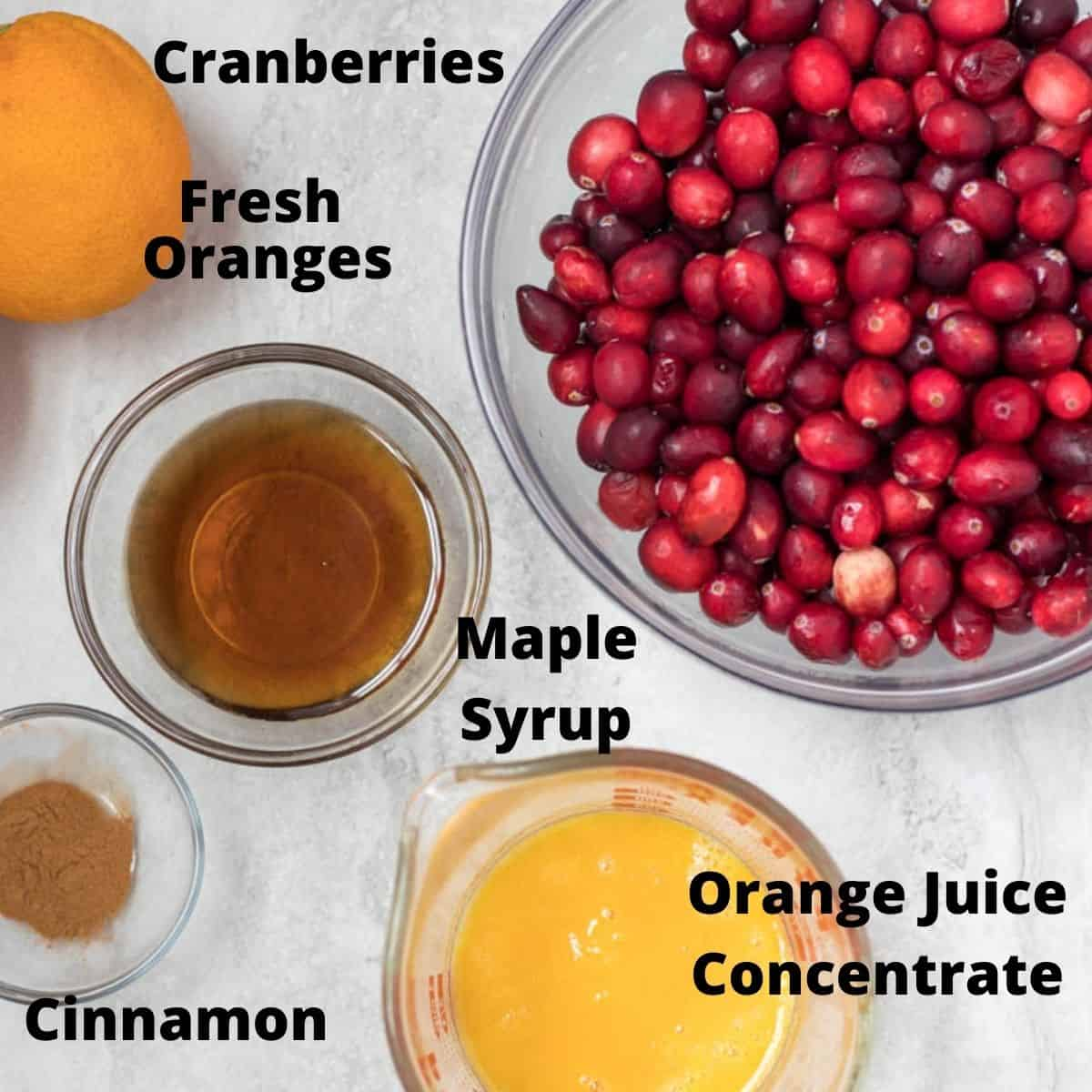 Ingredients for Cranberry Sauce labeled on white counter.