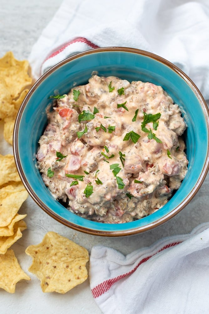 Blue bowl filled with cream cheese sausage dip