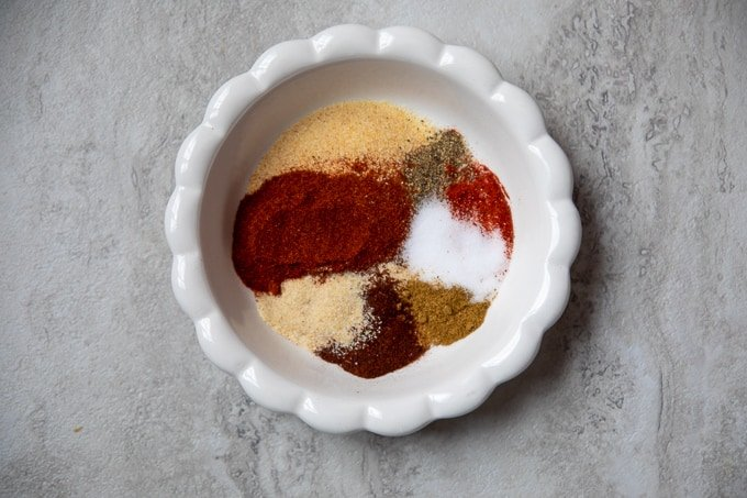 White bowl with spices used in fajita seasoning