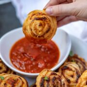 Pizza Roll Dipping in Marinara Sauce