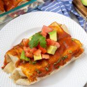 White plate with veggie enchiladas