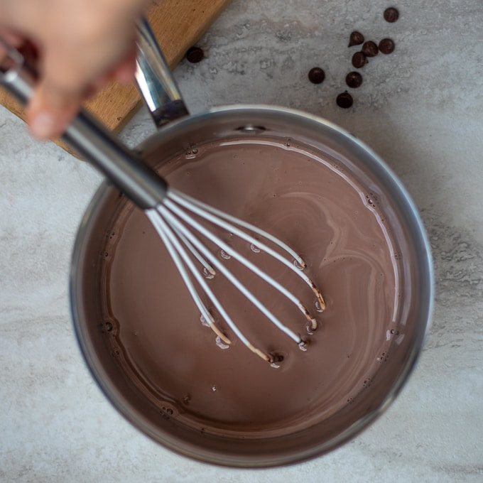 Whisk in saucepan of homemade hot chocolate