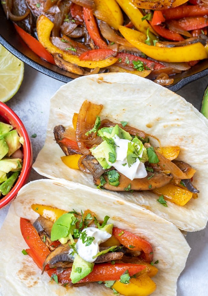 Vegetarian Fajitas in two flour tortillas next to skillet