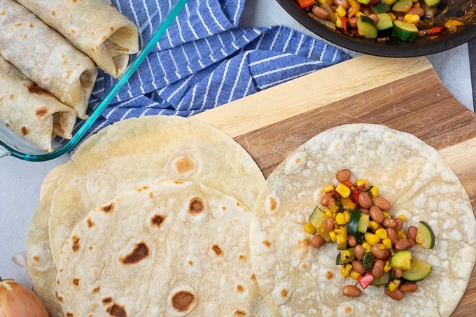 Tortilla with vegetable and bean mixture