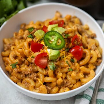 Bowl of Taco Pasta topped with tomatoes and avocado