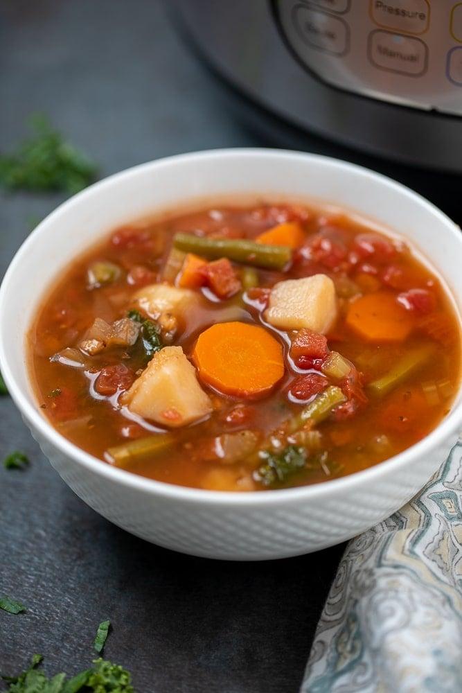 Bowl of Veggie Soup next to Instant Pot