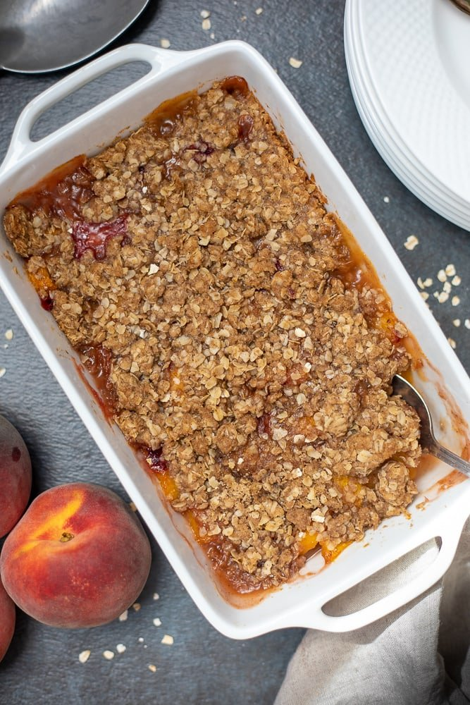 Baked Peach Crisp in White Casserole Dish
