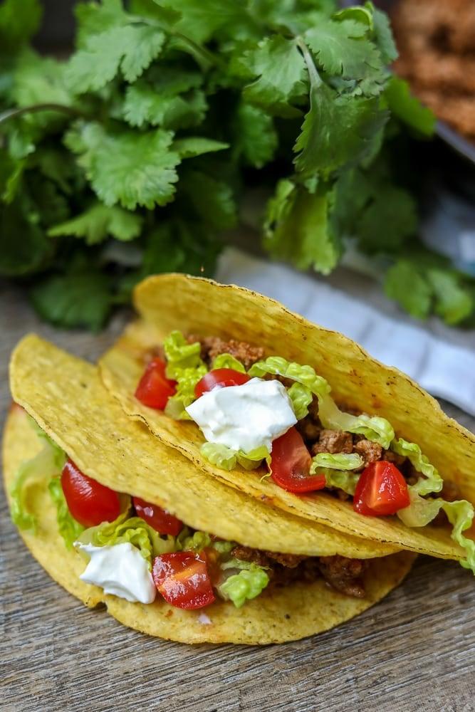 2 tacos on cutting board