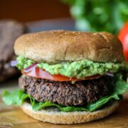 Black Bean Burger with Mashed Avocado on cutting board